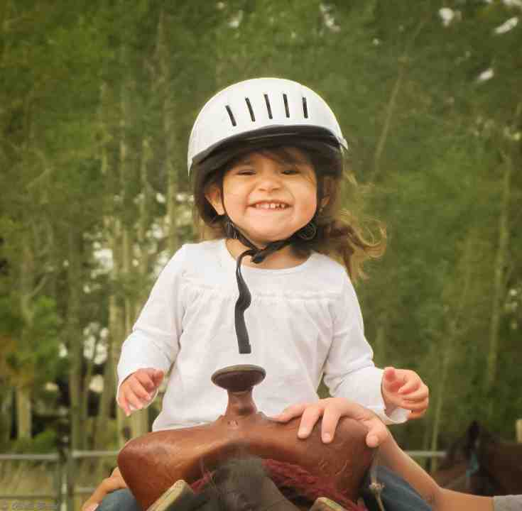 Kid with Helmet is Smiling